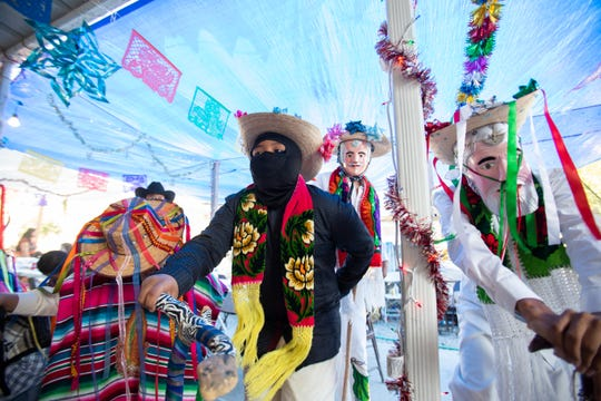 Boys from the Purepecha community dance in honor of the Virgin of Guadalupe on Dec. 12, 2019 at the Oasis Trailer Park in Thermal, Calif. The annual ritual has been performed by the Purepechas since 2003 in the Coachella Valley.