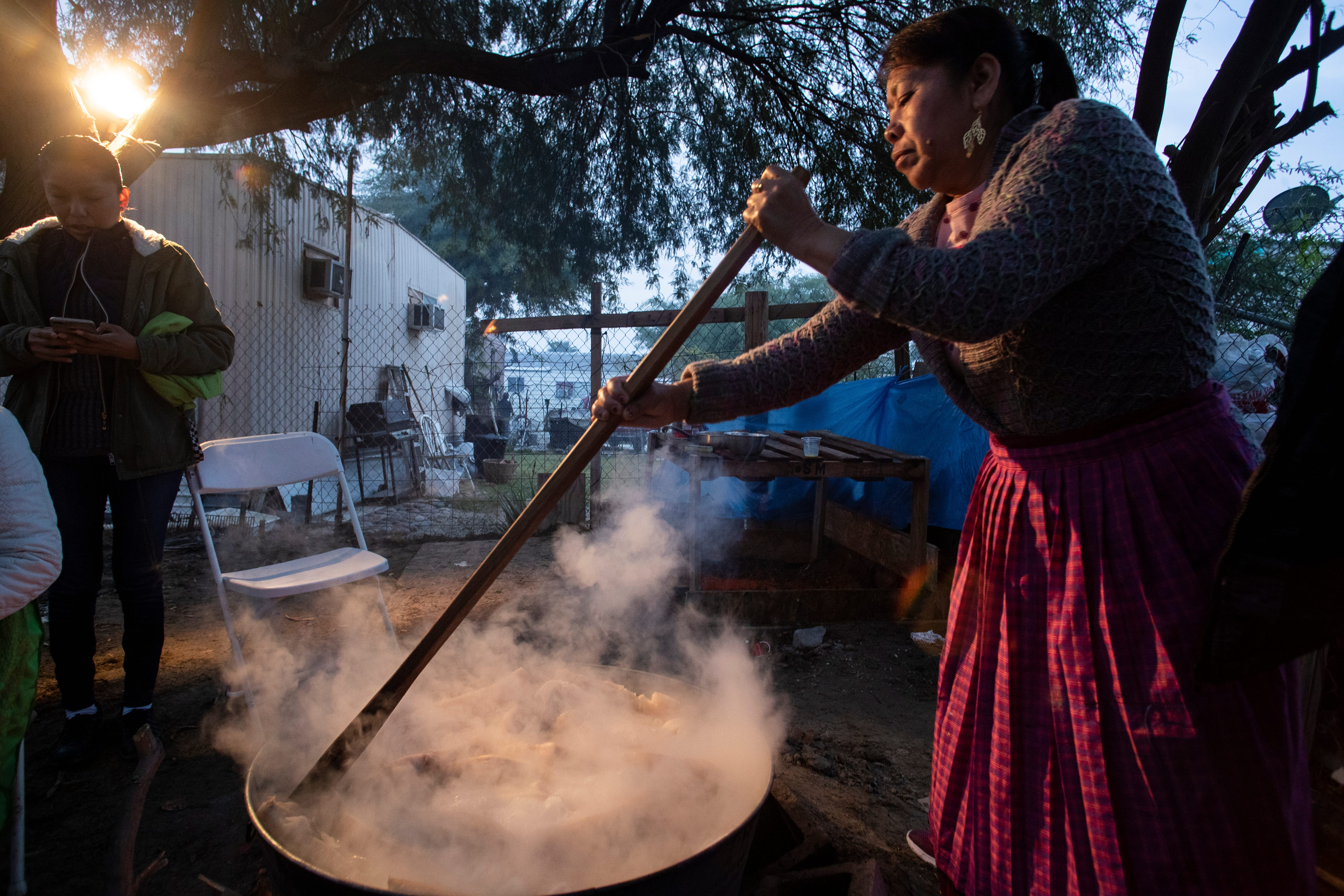 Florinda Serano begins preparing food at the break of dawn on Dec. 10, 2019, to feed the Purépecha community in Thermal, Calif. The community will gather to celebrate the Virgin of Guadalupe festivities.
