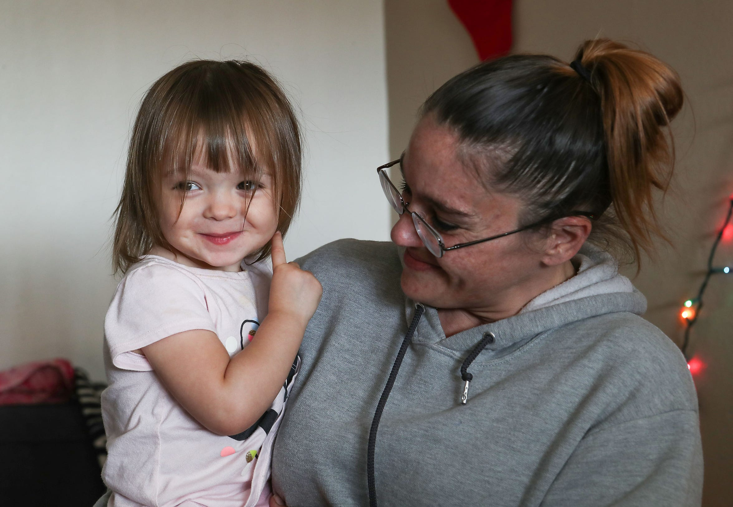 Erica Murphy holds her two-year-old Johanna in her Indio apartment.  Murphy spent seven years living homeless getting back on her feet, December 18, 2019.