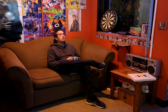 Matthieu Fragneau plays a video game at Glitch in Palm Springs, Calif., on Wednesday, December 18, 2019.
