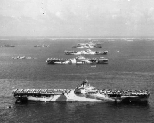 An aircraft flying over the U.S. Third Fleet's forward base at Ulithi Atoll on Dec. 8, 1944, captured five Essex-class aircraft carriers, the USS Wasp, USS Yorktown, USS Hornet, USS Hancock and USS Ticonderoga.