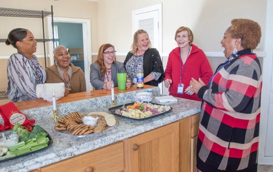 From left, current Re-entry Alliance Pensacola (REAP) residents Chrissie McMillan, Paula Baker, Alyssa Vaugh, Rachel Linton, Deborah Fritschle and women's program manager Rosetta P. Taylor have a laugh during an open house for a second women's house that is about to be opened in Pensacola on Wednesday, Dec. 18, 2019.
