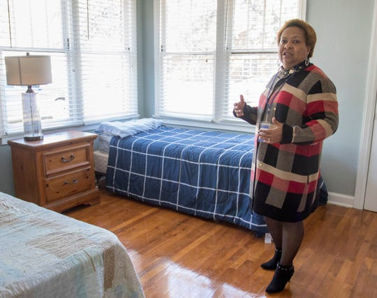 Re-entry Alliance Pensacola (REAP) women's program manager Rosetta P. Taylor gives a tour during an open house for a second women's house that is about to be opened in Pensacola on Wednesday, Dec. 18, 2019.
