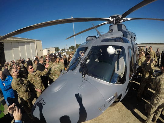 "Airmen and military contractors get an up close look at the U.S. Air ForceÕs newest helicopter, the MH-139A ""Grey Wolf,"" during a ceremony Thursday, Dec. 19, 2019 at Duke Field near Fort Walton Beach, Florida.  The MH-139A is a partnership between aerospace contractors Boeing and Leonardo and was designed specifically for the Air Force. It will replace an aging population of UH-1N ÒHueyÓ helicopters and provide security and support for U.S. missile installations across the mid- and northwestern United States once testing is completed at Duke Field."