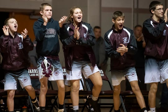 The Gettysburg bench reacts as Jake Cherry pins his opponent in the 138-pound bout on Wednesday, Dec. 18, 2019.
