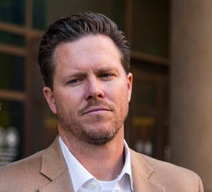 Kurt Altman, left, Paul Petersen's attorney, speaks to the press on the steps of Maricopa County Superior Court as Paul Petersen listens, Dec. 19, 2019.