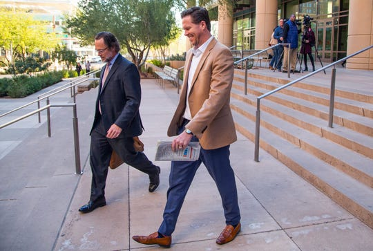 Paul Petersen, right, and his attorney, Kurt Altman, leave after Altman spoke to the press on the steps of Maricopa County Superior Court, Dec. 19, 2019.