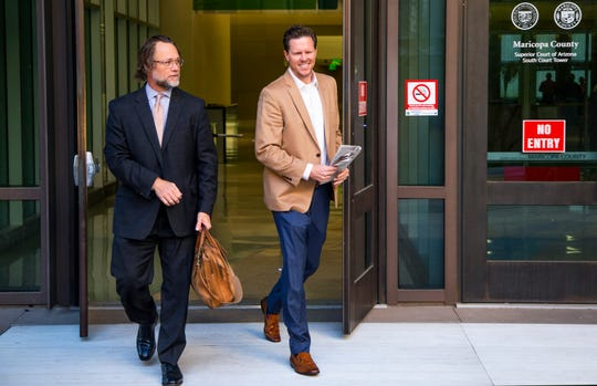 Paul Petersen leaves Maricopa County Superior Court with his attorney, Kurt Altman, left, on Dec. 19, 2019.
