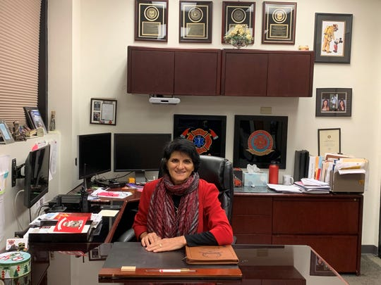 Mesa Fire Chief Mary Cameli at her office. Cameli will be honored with her citizen of the year award at a Feb. 18 banquet.