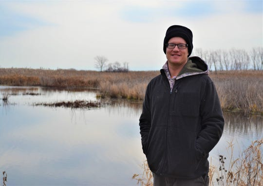 Winous Point Research Coordinator Brendan Shirkey stands at Winous Point Marsh Conservancy. A major element of his job is to manage the wildlife on the conservancy grounds, including the birds that summer there.