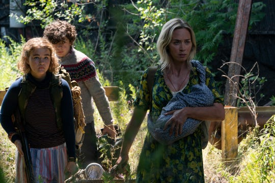 "From left, Millicent Simmonds, Marcus and Emily Blunt) in ""A Quiet Place Part II."""