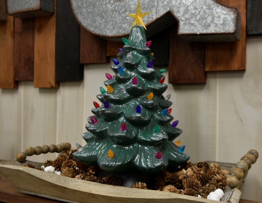Hand painted ceramic Christmas trees like this one were a big hit this year, according to Jamaica Wiley, owner of Hammer & Stain in Chambersburg. The retro decorations brought back memories of parents and grandparents who had one in their homes years ago.