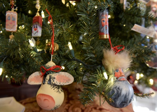Susan Shaffer of Joyful Arts Studio in Greencastle has made handcrafted ornaments out of a number of recycled items - shotgun shells, light bulbs, paper bags, dominoes, old keys and more.
