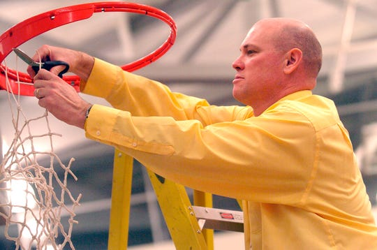 Red Lion head coach Don Dimoff cuts the net off the rim after the Lady Lions' win over West York in the York-Adams League basketball championship, Saturday, February 20, 2010. John A. Pavoncello photo