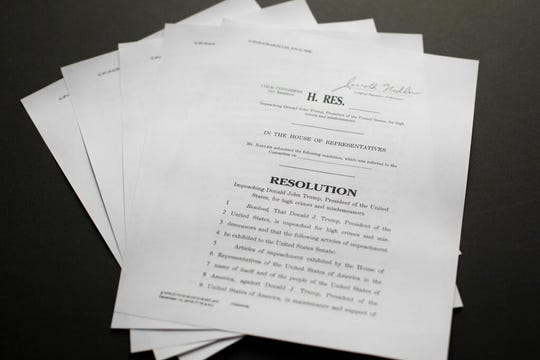 The articles of impeachment against President Donald Trump photographed on Dec. 10, 2019 in Washington. (AP Photo/Pablo Martinez Monsivais)