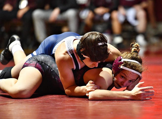 Gettysburg's Montana DeLawder, bottom, wrestles against Dallastown's Zach Luckenbaugh, in December. Because of rule changes, life for high school female wrestlers, such as DeLawder, should get a little easier in the future. Dawn J. Sagert photo