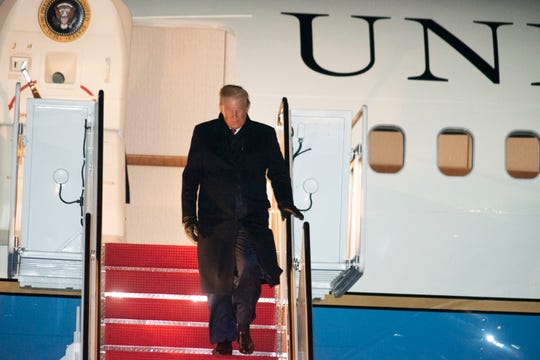 President Donald Trump exits Air Force One on Wednesday, Dec. 18, 2019, at Andrews Air Force Base, Md., following a campaign trip to Battle Creek, Mich. (AP Photo/Kevin Wolf)