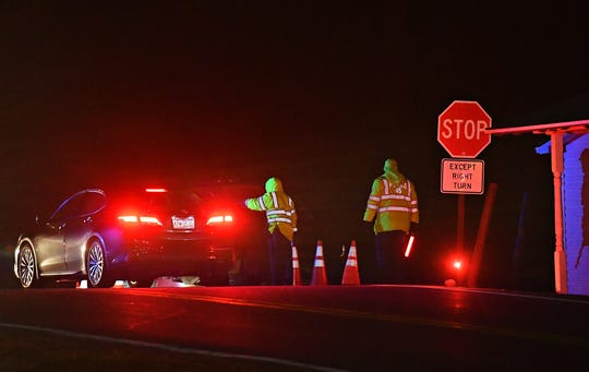 Fire police block access to Marsteller Road as officials work a fatal structure fire in Hopewell Township, Wednesday, Dec. 18, 2019. Dawn J. Sagert photo