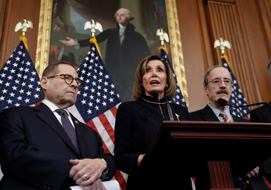 Speaker of the House Nancy Pelosi, D-Calif., flanked by House Judiciary Committee Chairman Jerrold Nadler, D-N.Y., left, and House Foreign Affairs Committee Chairman Eliot Engel, D-N.Y., speaks reporters at the Capitol in Washington, Wednesday, Dec. 18, 2019, after the House of Representatives voted to impeach President Donald Trump on two charges, abuse of power and obstruction of Congress. (AP Photo/J. Scott Applewhite)