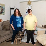 Jennifer Fink (left), Alex Kepner (right) and their dog Cassie are hopefully for their future, December 18, 2019.