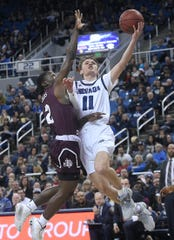 Nevada's Kane Milling (11) drives against Texas Southern during the Wolf Pack's win on Wednesday.