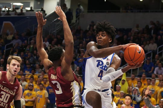 Pittsburgh Panthers guard Gerald Drumgoole (4) drives to the basket against Florida State Seminoles guard Trent Forrest (3) during the first half at the Petersen Events Center.