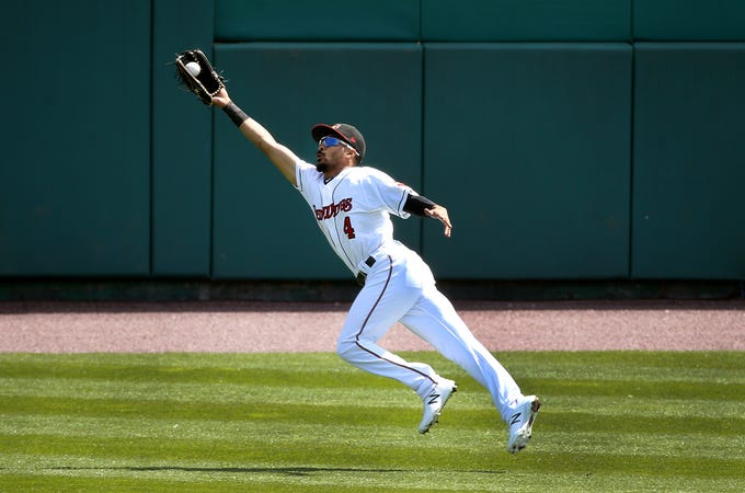 Rochester right fielder Lamonte Wade Jr, makes a lunging catch on a ball hit in the gap by Syracuse's Adeiny Hechavarria.  The Red Wings held on to win 5-4.