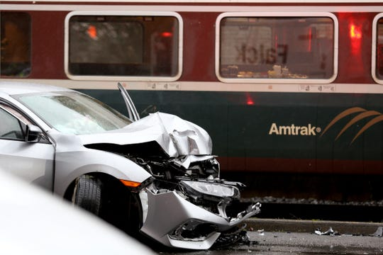 A car was hit by a train at Court St. NE near 12th St. NE in Salem on Dec. 19, 2019. The car turned the wrong way on a one-way street and stopped on the tracks as the Amtrak train was pulling into the Salem Railroad Station. The two people in the car were taken to the hospital with non-life-threatening injuries and no one on the train was hurt.