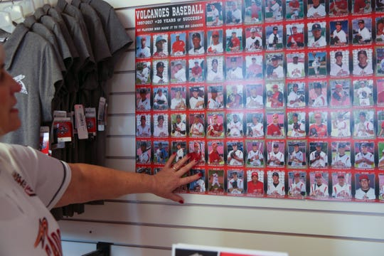 JoAnn Wood gestures to Volcanoes players that have gone on to Major League Baseball at the Volcanoes Stadium in Keizer, Ore. on Dec. 18, 2019. They have been Volcanoes season ticket holders for 23 years.
