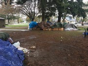 Up to 20 people camped at Marion Square Park the day after a camping ban was enforced in downtown Salem.
