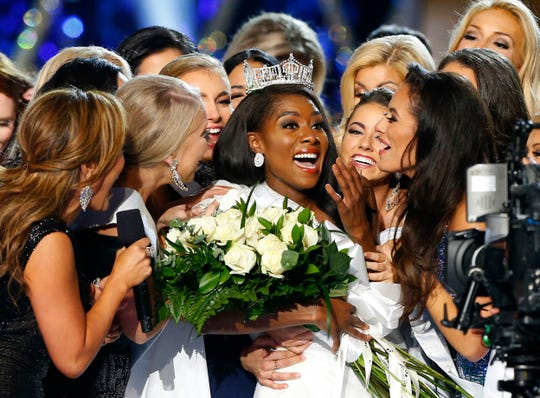 This Sept. 9, 2018 file photo shows Miss New York Nia Franklin, center, reacting after being named Miss America 2019 in Atlantic City, N.J.