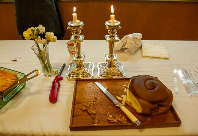Before they eat, they have to light the Sabbath candles and the Shabbat dinner is eaten before the start of the service.