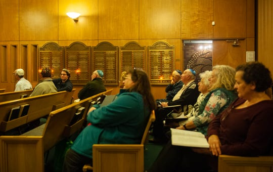 Members of the Temple Beth El sit down before the start of the weekly Shabbat  service on Friday night.