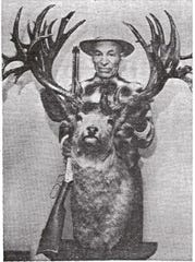 Ed Broder poses with the trophy mule deer buck he harvested in Alberta, Canada, in 1926. He didn't learn that it was a world record until 1962.