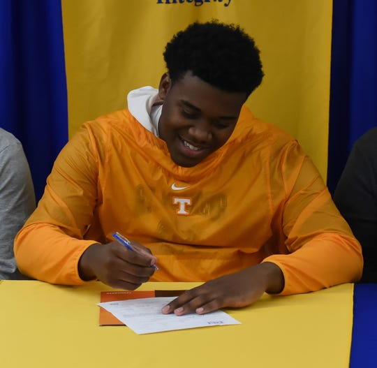 Dominic Bailey signs his national letter of intent to play football at the University of Tennessee on Wednesday, Dec. 18, 2019.