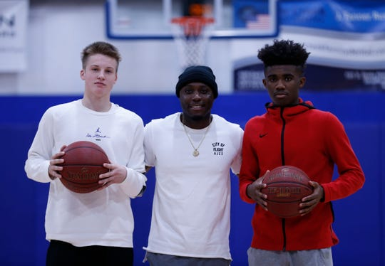 From left, Isaac Haney, Robert Yanders and Anton Brookshire pose for a photo at The Basketball Movement Gym in Nixa.
