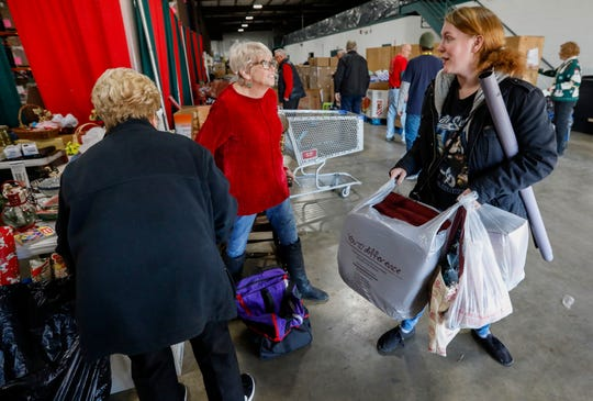 Denise Wright, right, talks with volunteers during distribution day for Share Your Christmas at Crosslines on Thursday, Dec. 19, 2019.