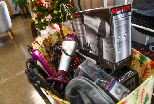 Donated styling equipment and supplies is collected for donation to  Anna Marie's Alliance Thursday, Dec. 19, 2019, at Poppy Salon in Waite Park,