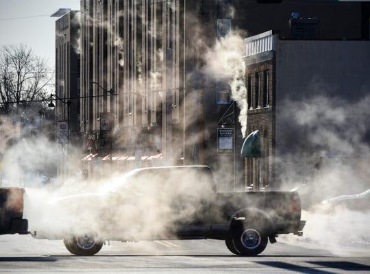 Morning sunlight highlights steam and exhaust as traffic travels along Minnesota Highway 23 near the intersection with Fifth Avenue South Wednesday, Jan. 30, 2019, in St. Cloud as temperatures hovered around minus 30.