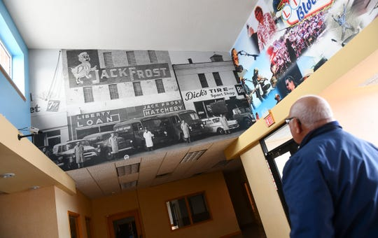 Great River Children's Museum treasurer Greg Reigstad shows an area or the facility containing vintage photos of the block Wednesday, Dec. 18, 2019, in St. Cloud.