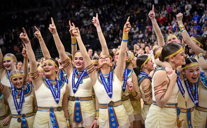 Sartell dancers celebrate their first place finish Saturday, Feb. 16, following the Minnesota Dance Team High Kick finals at the Target Center in Minneapolis.