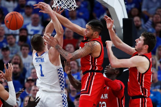 Kentucky's Nate Sestina, left, and Utah's Timmy Allen (1) compete for a rebound during the first half of an NCAA college basketball game Wednesday, Dec. 18, 2019, in Las Vegas. (AP Photo/John Locher)