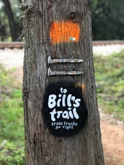 Trail markers point the way to Bill's Trail.