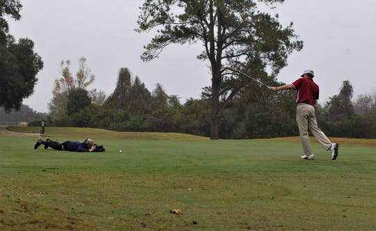 Tallahassee Democrat photographer Alicia Devine works on All-Big Bend photos with Chiles sophomore golfer Parker Bell during a photo shoot at Killearn Country Club on Dec. 11, 2019.