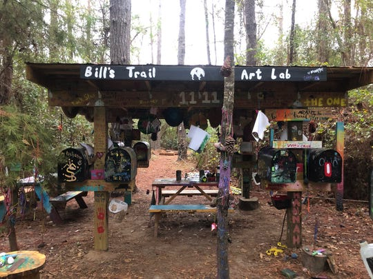 """Heavily painted tables and roof structure that make up the """"Art Lab"""" of Bill's Trail."""