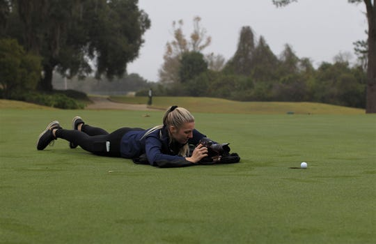 Tallahassee Democrat photographer Alicia Devine works on All-Big Bend photos during a photo shoot at Killearn Country Club on Dec. 11, 2019.