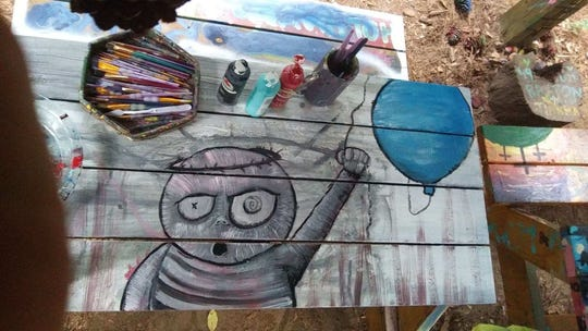 Original artwork of Ashton Stephen. Painted on the picnic tables of Bill's Trail. Most artwork has been painted over.