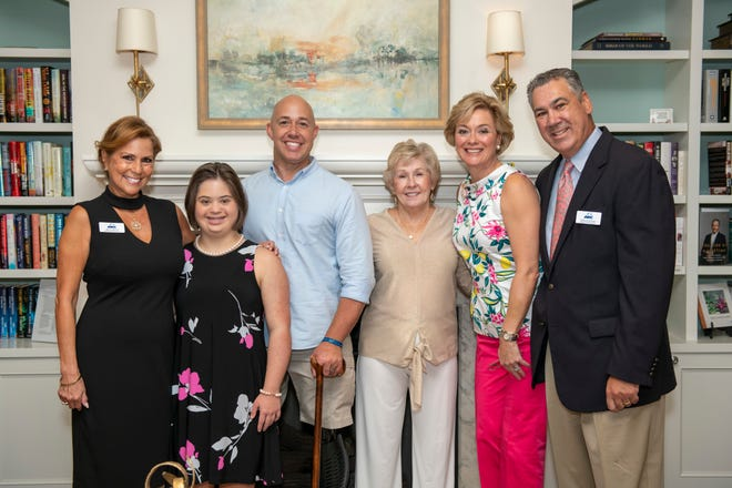 ARC of Martin County's Charity Golf Tournament was attended by Maria Reich, left, committee member;  Jacquie Kemm, guest performer; Congressman Brian Mast, Barb Flowers, committee chair and Barbara and Ed Kemm, chairman of the ARC board of directors.