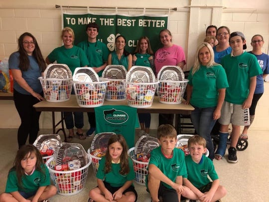 "Students in the Martin County Clovers 4-H Club collected food and supplies as part of Elev8Hope's ""Wave of Compassion in Action"" project  to provide deserving Martin County families with Thanksgiving dinners."