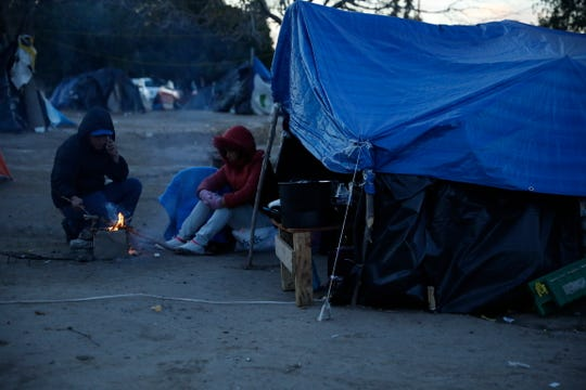 Mexican asylum-seekers camp in the Chamizal park in Juárez on Wednesday night, Dec. 18, 2019.